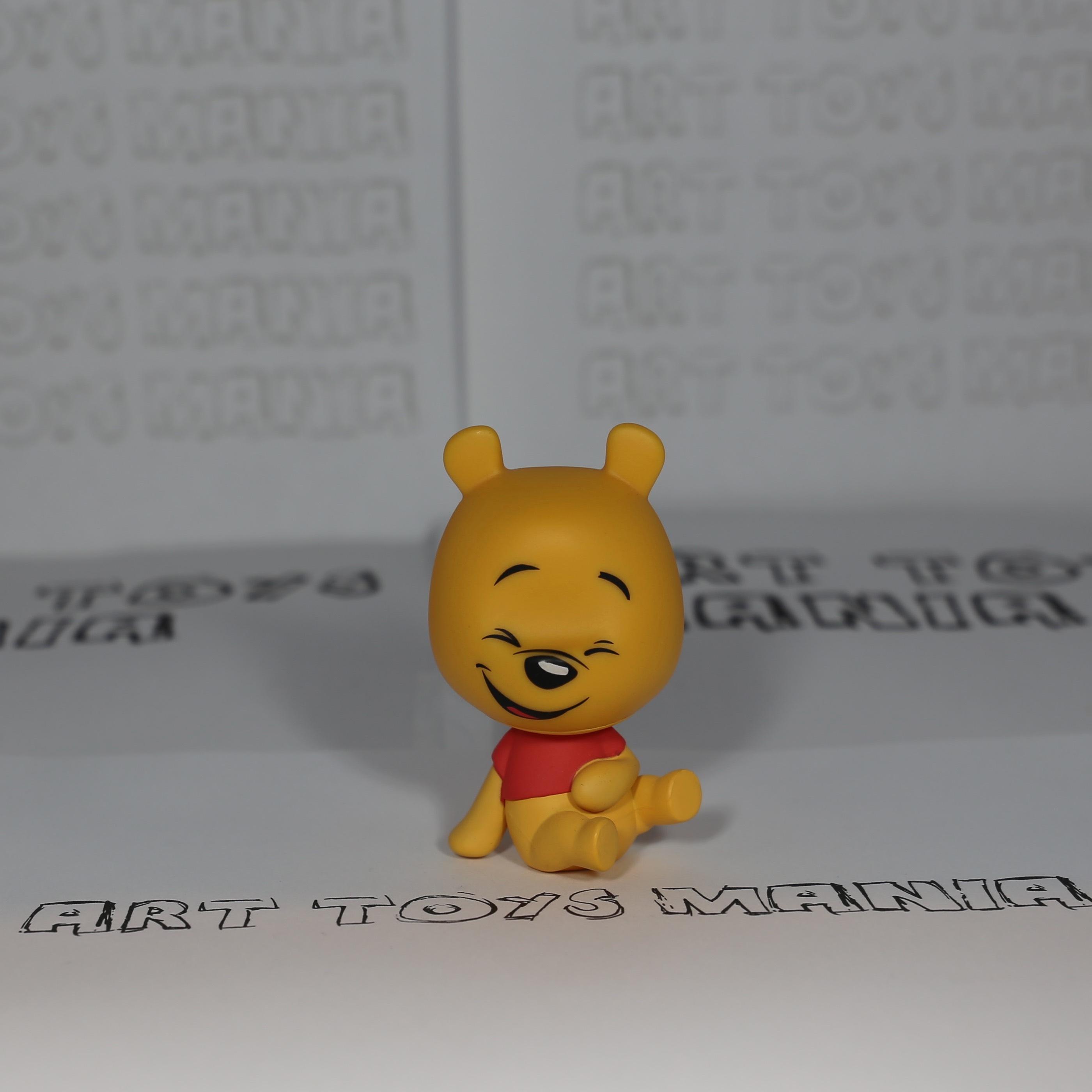 Winnie Pooh seated